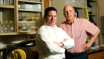 Two men pose in nutrition laboratory