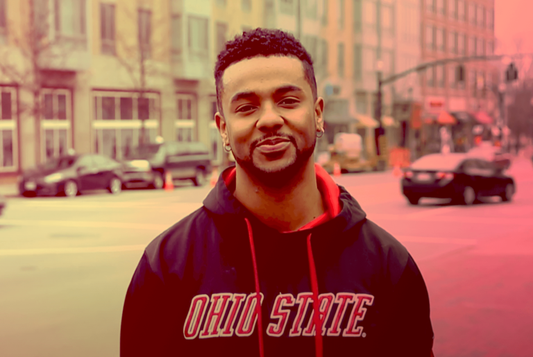 Image of a Black man with hooped earrings and a black Ohio State hoodie