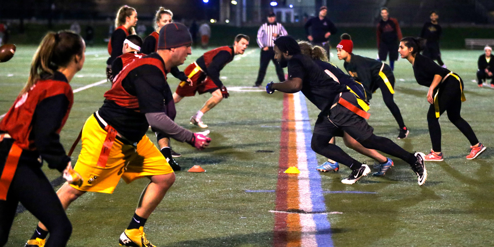Ohio State students run a play during a coed recreation flag football game